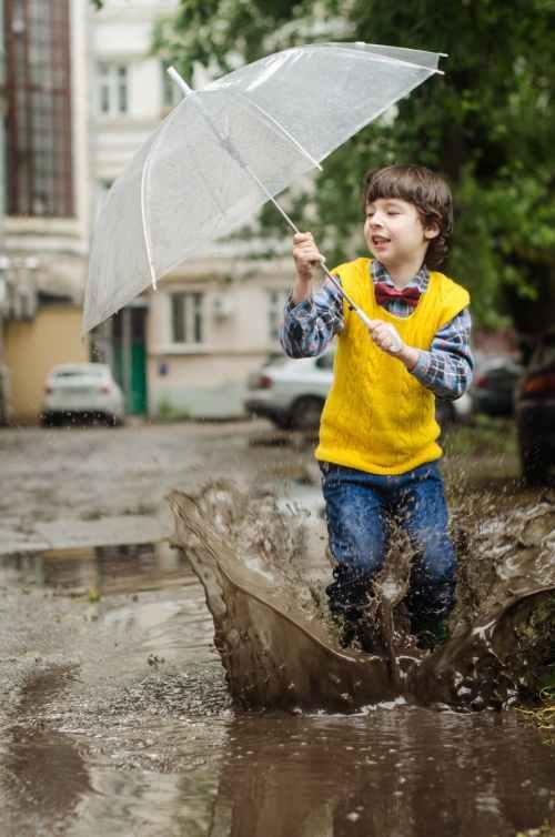 boy holding clear umbrella